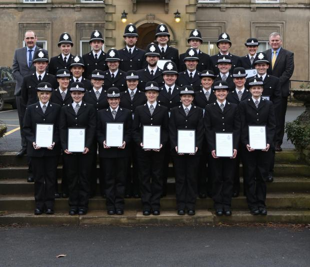 The new recruits following the passing out ceremony with trainers Mick Boothroyd (left) and Fred Burn (right)