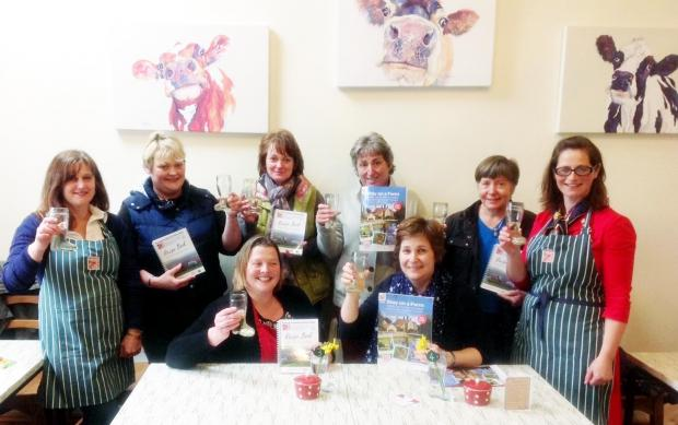 Darlington and Stockton Times: CELEBRATING: Yorkshire Farm Stay members with copies of their successful recipe book