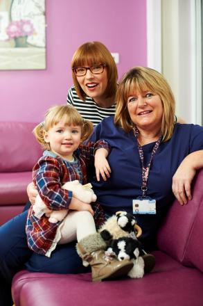 NATIONAL AWARD: Mother Claire Tasker, left with daughter Lily, has nominated midwife Ann Marsden for a national award.