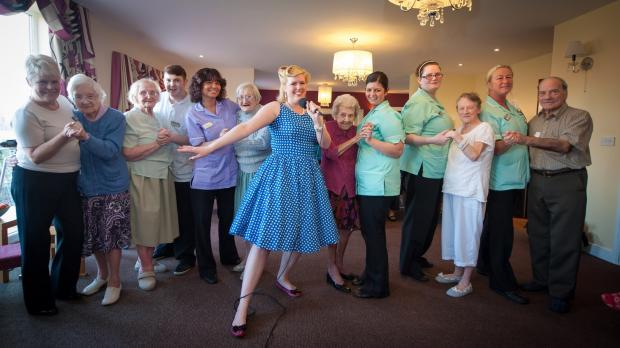 Claire Louise entertains residents in the Yew Tree Care Centre