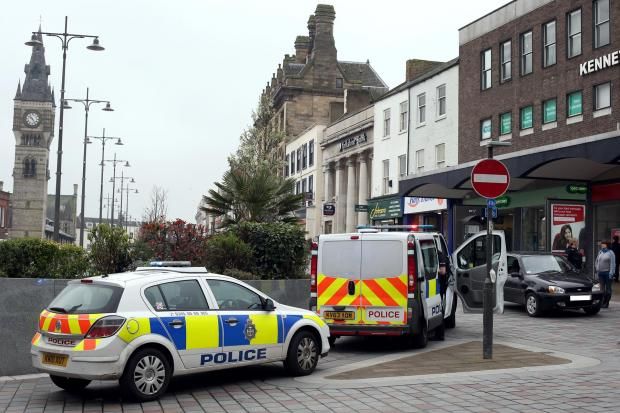 CASH DASH: Police at the scene of this morning's incident in High Row