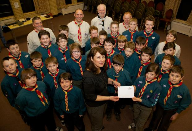 FUNDS BOOST: Bridget Charlton, marketing manager of Simon Bailes Peugeot, hands over the cheque to the scout group.