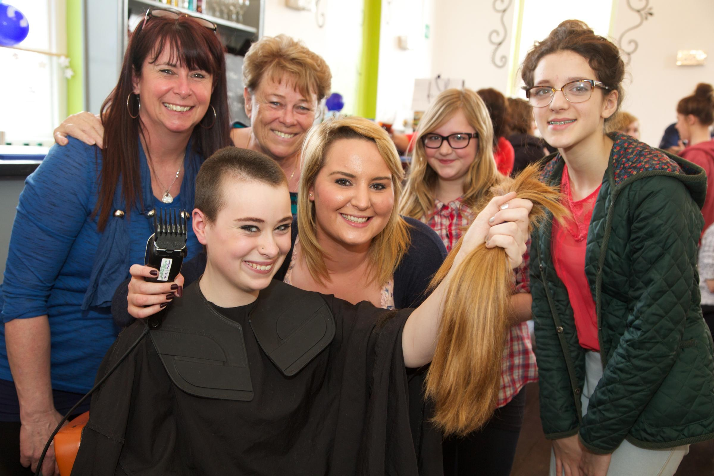Toni-Jay Brocklesby with hairdresser Jemma Hunter and supporters