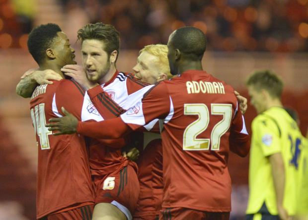 Darlington and Stockton Times: DOUBLE JOY: Jacob Butterfield is mobbed by his Boro teammates after making it 2-0 last night, striking in a volley from distance