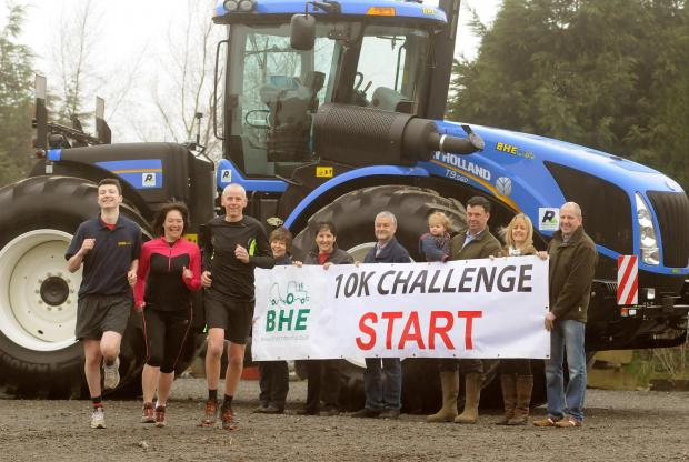 Getting ready for the Helmsley 10k run. Pictured in front of a giant New Holland T9 tractor are from the left, Will Dunn, Elaine Burgess, Steve Burgess, Vicky Tomlinson. Carol Swift, David Tomlinson, Simon and Sophie Dunn, Gill and Tim Glover.