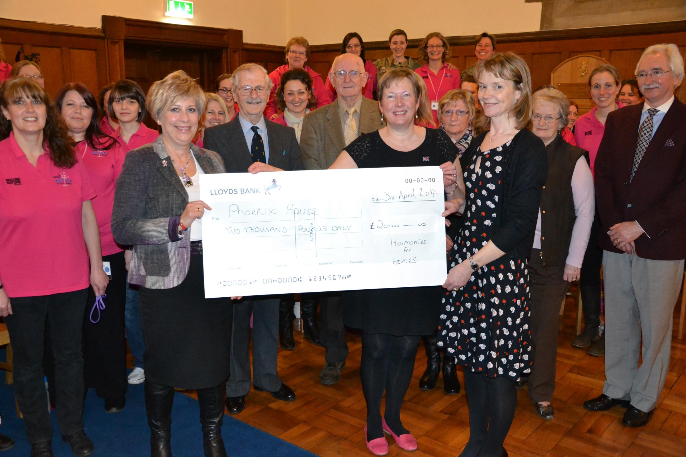 Carol Gedye and Jill Lundberg presenting the cheque to Jill Grainge of Help For Heroes with members of  the Military WAGS Choir Catterick and Muker and Reeth Band.