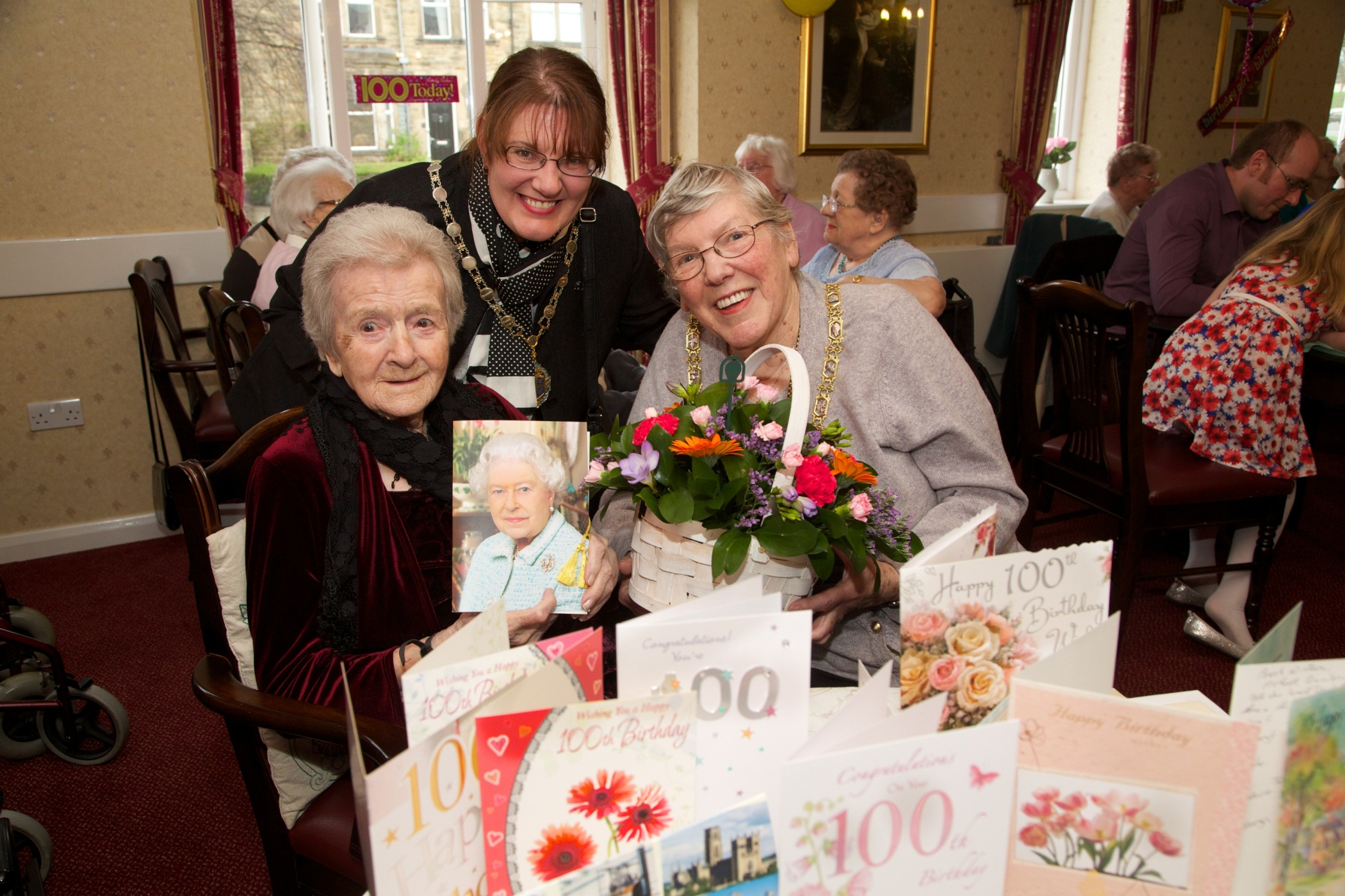 HAPPY BIRTHDAY: Centenarian Gladys Stirk celebrates with the chairman of Durham County Council, Councillor Pauline Charlton who along with her daughter and consort, Susie Charlton, presented her with a basket of flowers.
