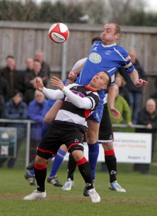 MY BALL: Padiham centre-back Martin Parkes climbs above Quakers' Stephen Thompson