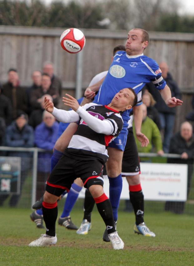 Darlington and Stockton Times: MY BALL: Padiham centre-back Martin Parkes climbs above Quakers' Stephen Thompson