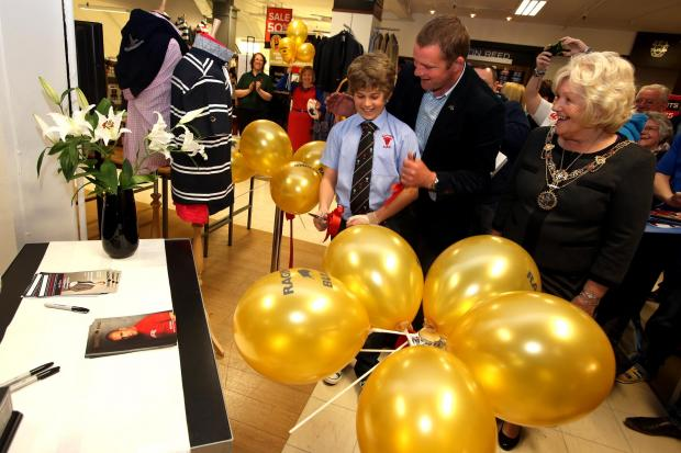 Darlington and Stockton Times: Former England rugby union player Phil Vickery MBE appears at the store to launch his new clothing line.  Pictured perfroming the opening with George Bell (14) who plays for the Darlingtion RFU u-14s team