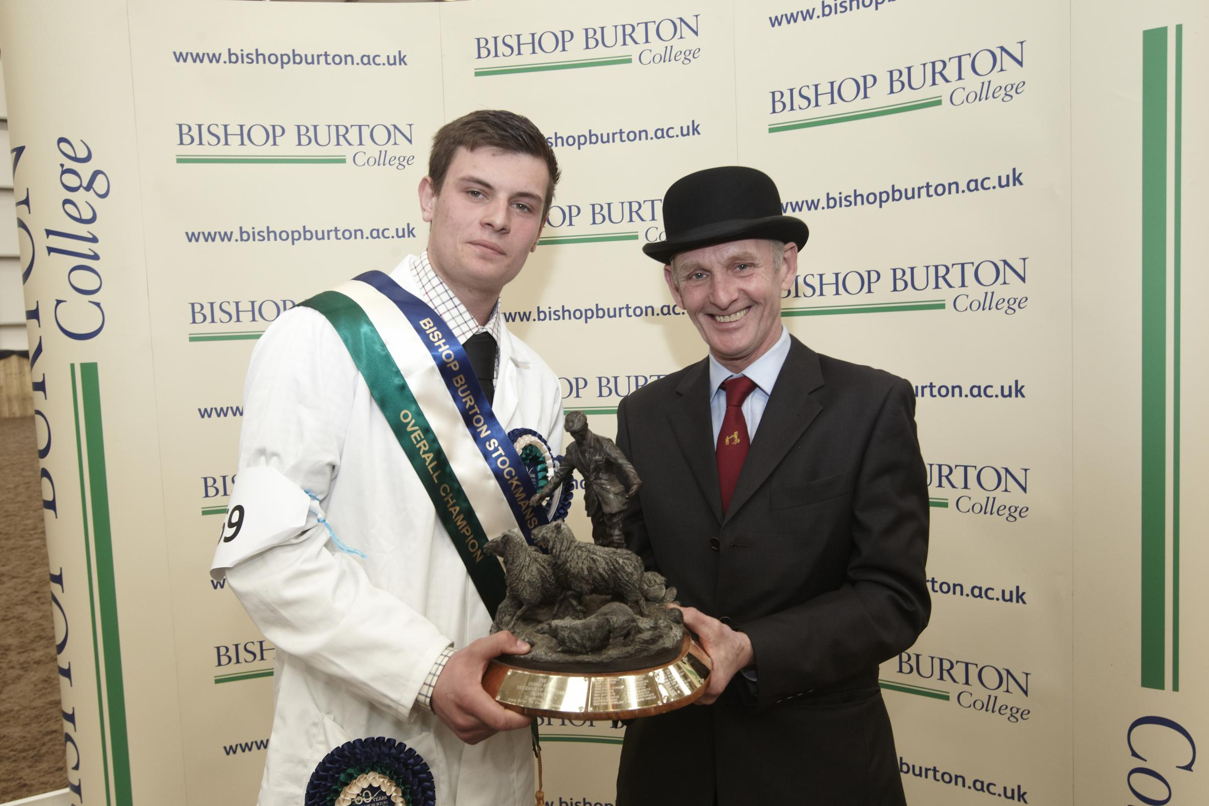 CHAMPION: Tyler Sambrook receives the trophy from judge David Abram