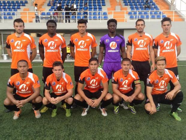 Darlington and Stockton Times: EASTERN PROMISE: Former Northallerton Town player Graham Caygill (top row, third from left) lines up with the Manila-based Loyola Meralco Sparks team ahead of his debut match.