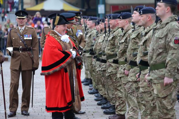 Darlington and Stockton Times: The Mayor of Darlington, Councillor Charles Johnson, inspects the troops in the market square