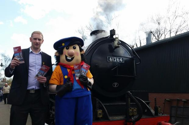 Craig Nattress, visitor economy officer for Visit Ryedale joins forces with the railway's mascot, Tracker Jack, to launch the new brochure. Pictures courtesy of the North Yorkshire Moors Railway.
