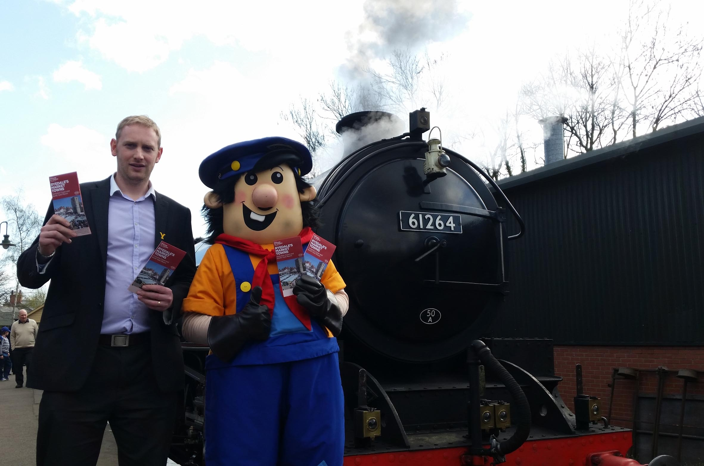 Craig Nattress, visitor economy officer for Visit Ryedale joins forces with the railway's mascot, Tracker Jack, to launch the new brochure. Pictur