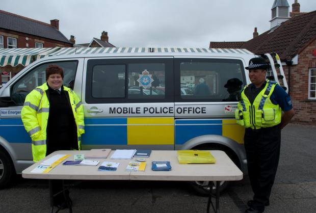 Organisational Support Officer Sarah Gardiner and PCSO Lucy Walker in Easingwold market place..