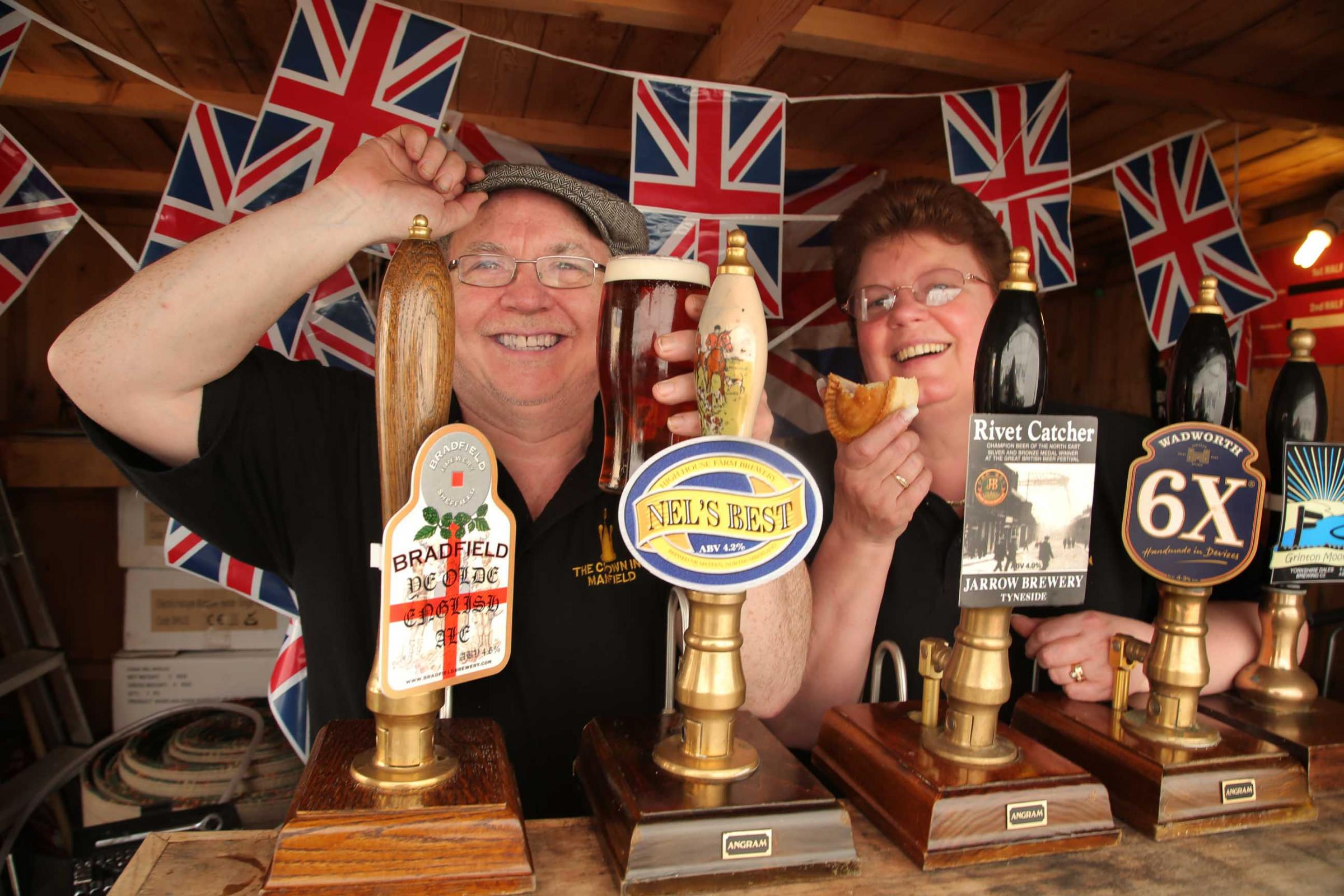 HOW BRITISH: Hosts Peter and Karen Hynes get into the spirit of things with flat cap, beer and pork pies for the forthcoming Very British Beer Festival at The Crown Inn, Manfield
