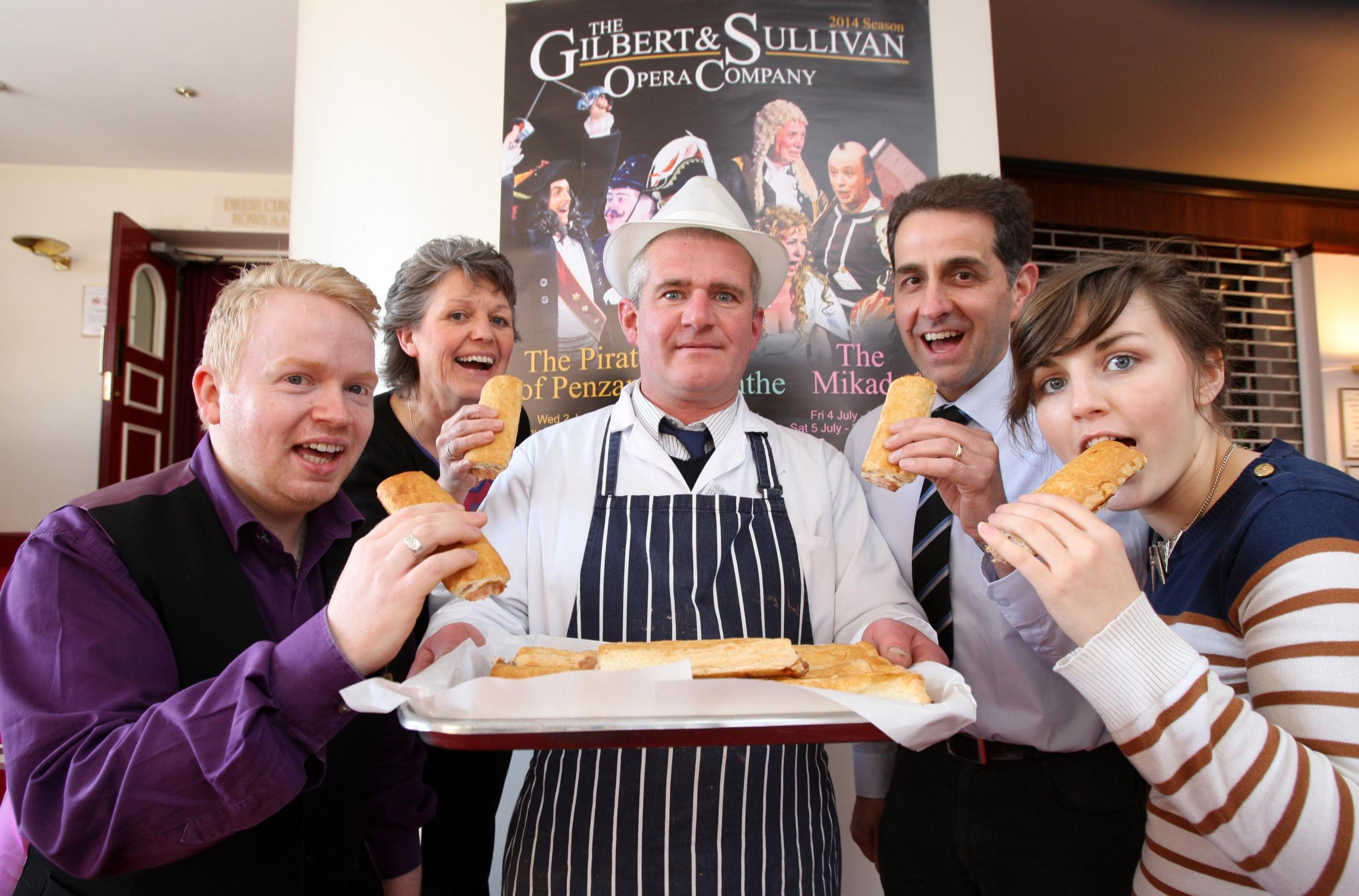 ROLL WITH IT: Stephen Feary, centre, of D Pittaway butchers, with staff from Darlington Civic Theatre