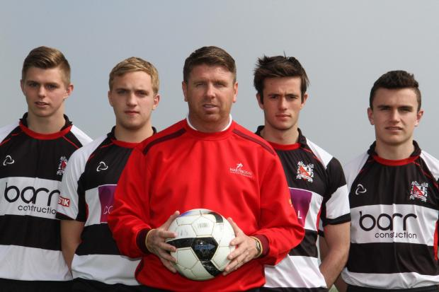 ON THE BALL: Darlington manager Martin Gray, centre, with students, (from left), Matty Lovegreen, Dave Mitchell, Adam Cocks and Aiden O'Connor