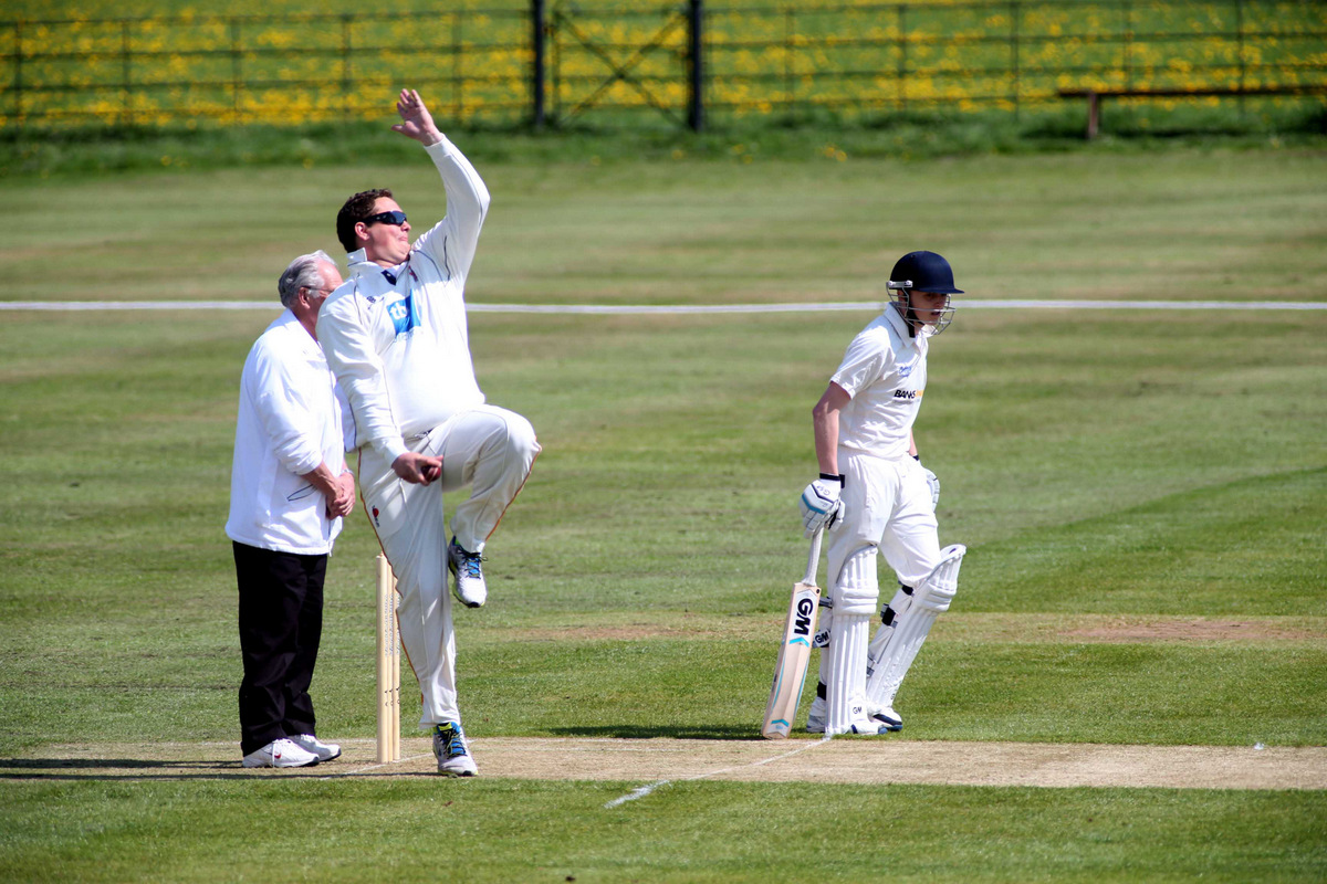 SPECIAL DELIVERY: Barnard Castle bowler James Finch in action with Sedgefield batsman Connor Whitelock backing up