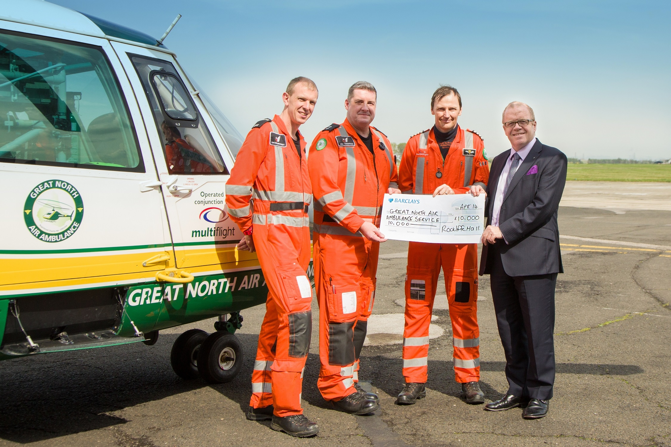 - Nick Holmes (MD Rockliffe Hall) hands over the cheque to some of the GNAAS team at their base at Durham Tees Valley Airport (Photo by Stan Seaton Photography)