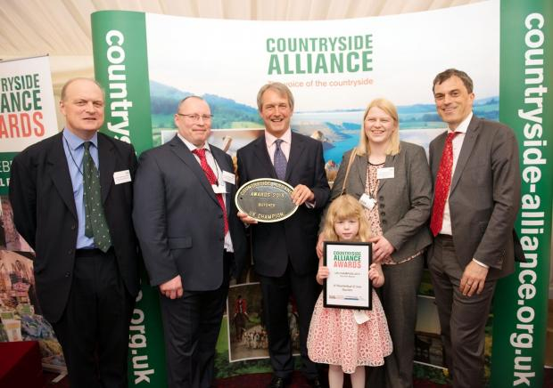 TOP BUTCHERT: Pictured at the Countryside Alliance Awards are (l-r) executive chairman Sir Barney White-Spunner, CA executive chairman; Andrew Weatherhead; Owen Paterson, Environment Secretary; Sally and Molly Weatherhead, and Julian Smith, MP for Skipton