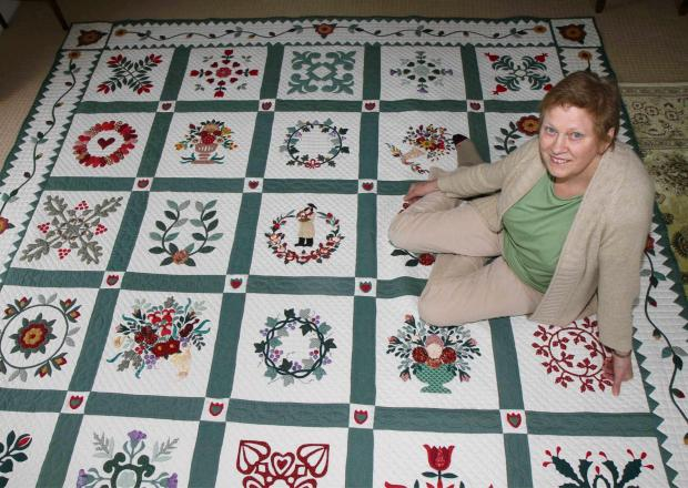 QUILT ART: Ena Bradley with the completed quilt, which depicts the Ripon Hornblower.