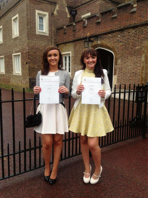 Darlington and Stockton Times: Lucy and Emily Anderson with their Duke of Edinburgh Gold Award certificates at St James's Palace
