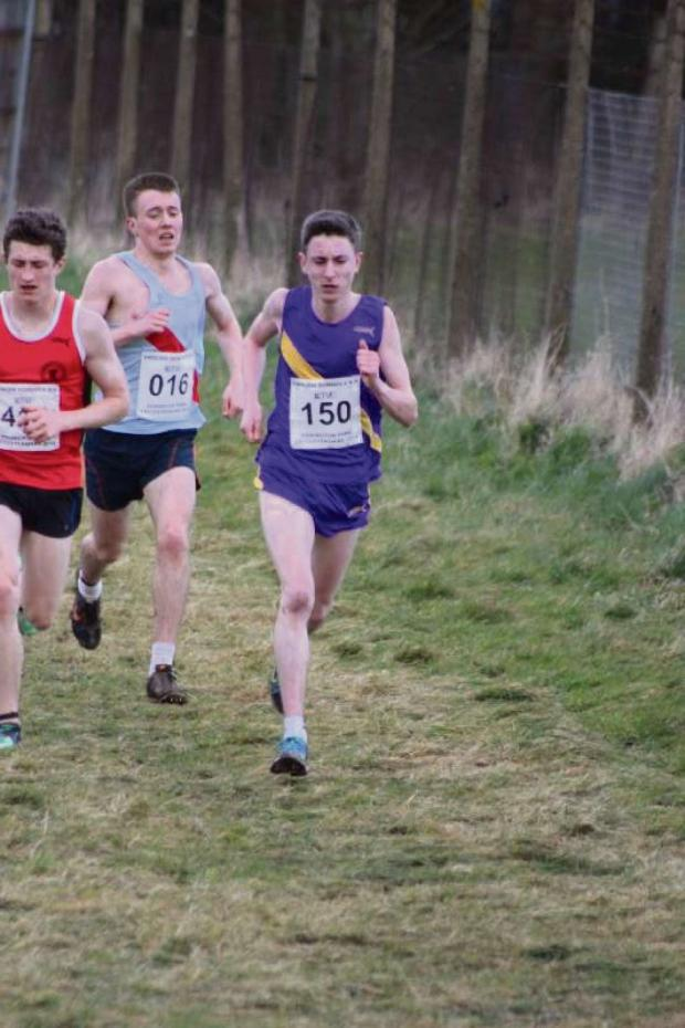 Darlington and Stockton Times: TOP FINISHER: Carmel College student Dean Newton, right, in action