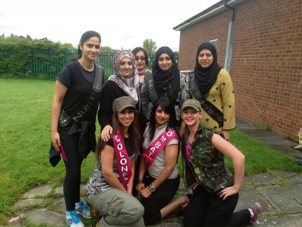 Darlington and Stockton Times: The Nur Pink Army is limbering up for the Race for Life after taking part in a military-style bootcamp back row l-r Samina Sarwar, Mehnaz Rashid, Parveen  Akhtar, Nageena Mahmoud and Naseem Mahmoud and front row l-r Shazia Noor, Zahra Shan and Gemma Ord.