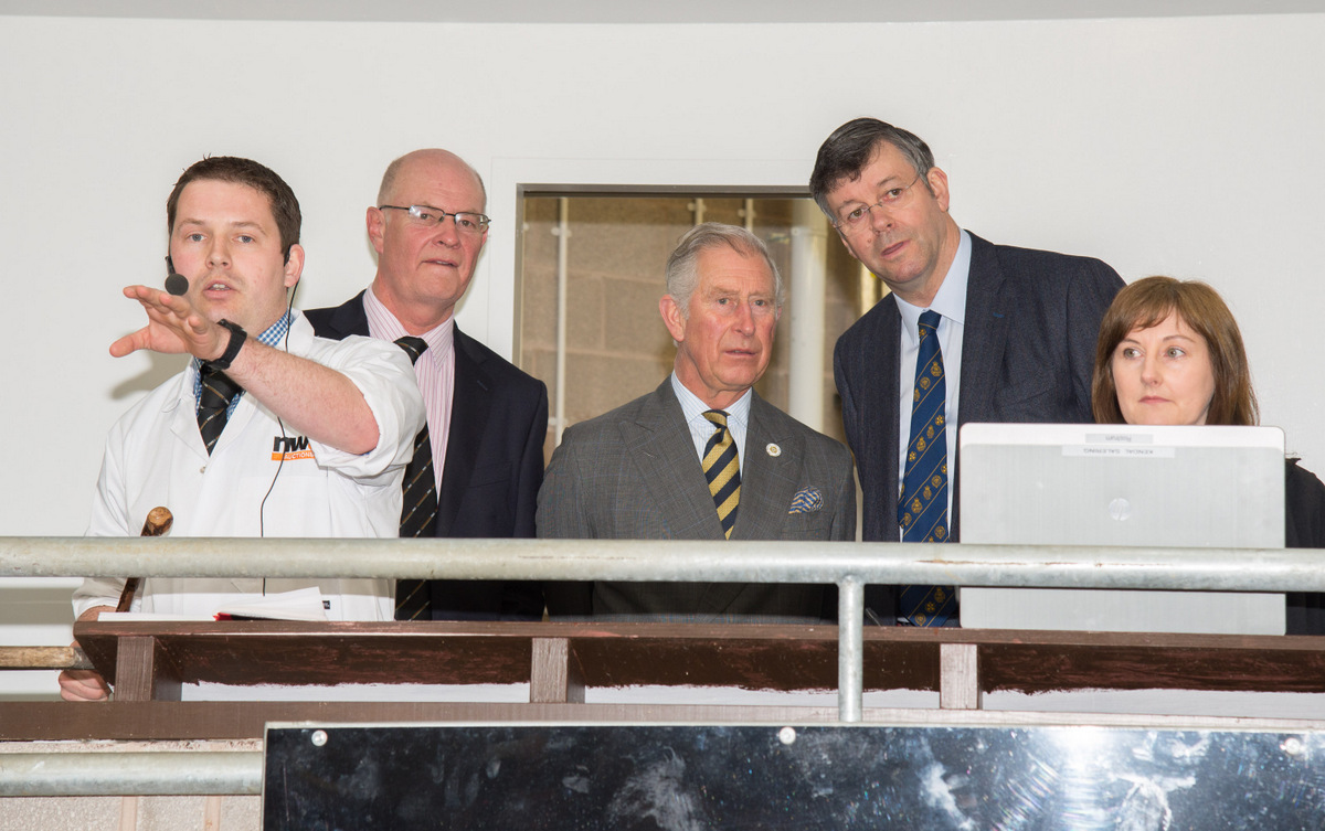 ROYAL VISIT: the Prince of Wales, centre, watches the auction of Lakeland Herdwick lambs flanked by, from left, Matthew Probert, John Drinkall, John Geldard, and Margaret Dodgson