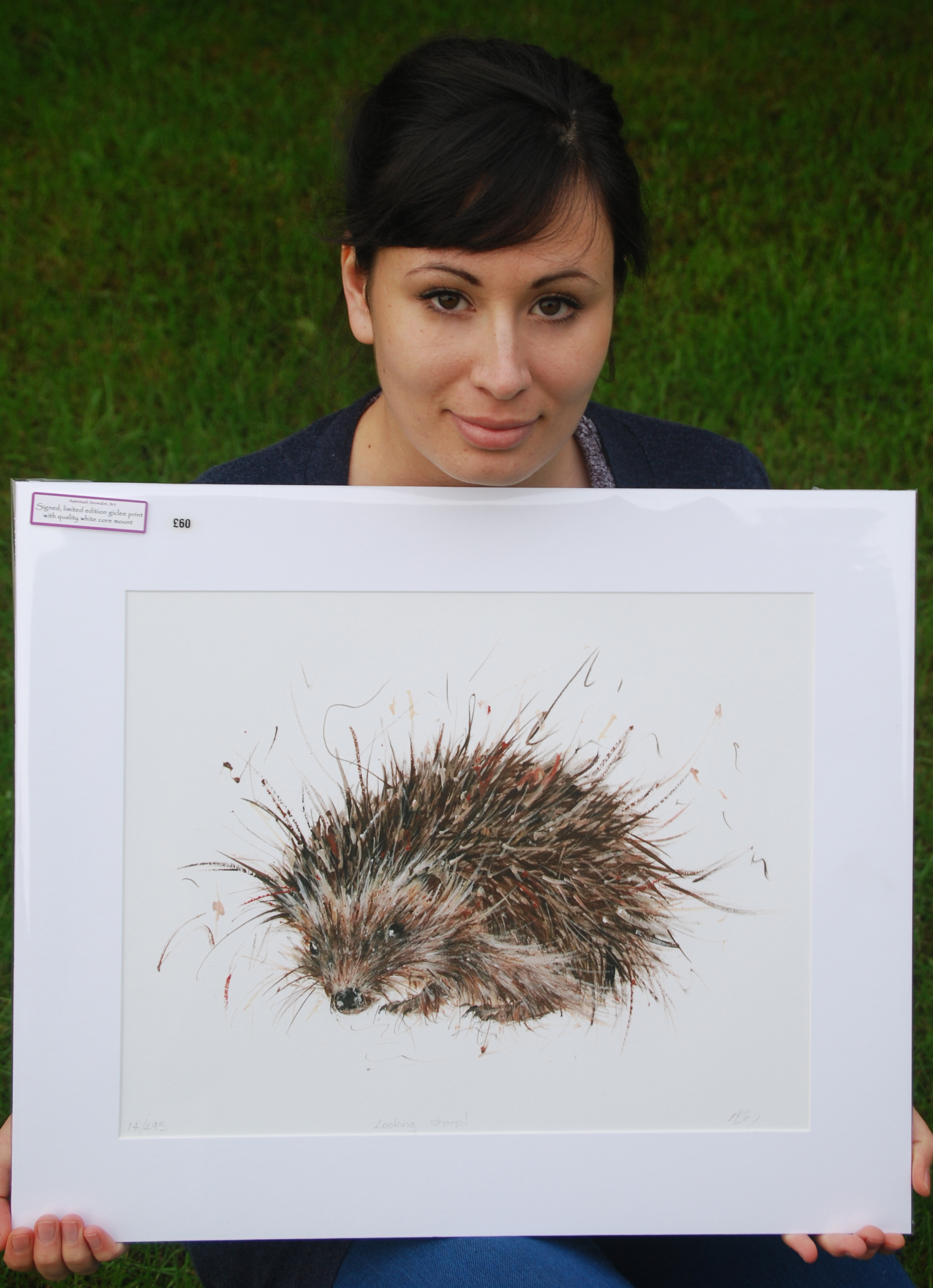 HELPING ANIMALS: Aaminah Snowdon with her hedgehog painting.