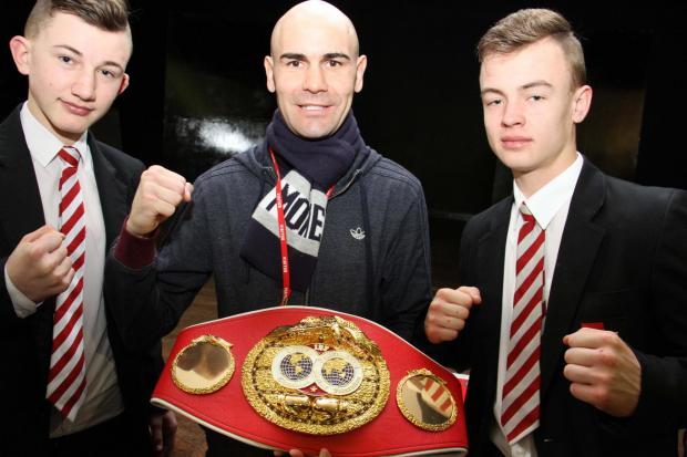 INSPIRATION: DSMS students Ben Durham, left, and Ellis Austin, both 14, with IBF world champion boxer Stuart Hall