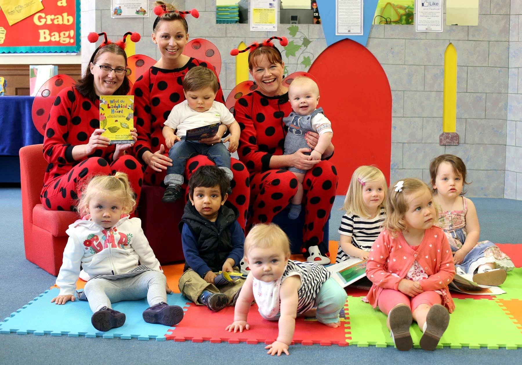 IT'S STORYTIME: Staff at Crown Street Library, Darlington dress up as laybirds prior to the children's story time book group session to promote the coming of 'What the Ladybird Heard' to the Civic Theatre