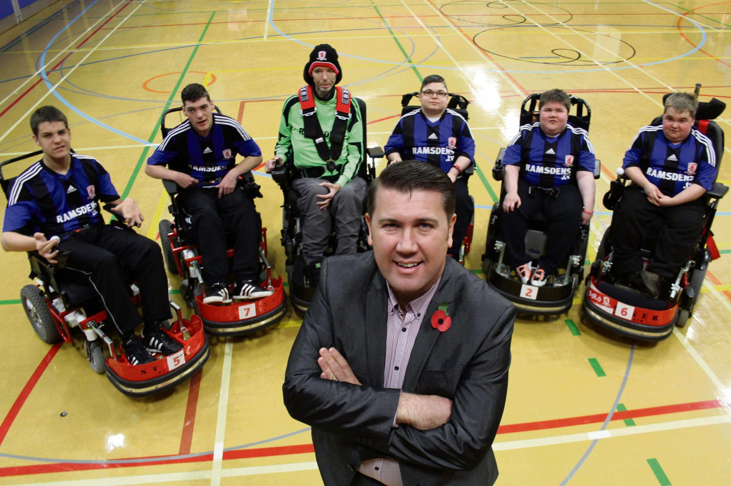 FUNDING GOAL: SiMon Scotchbrook, a patron of Middlesbrough and Teesside Philanthropic Foundation, with members of Middlesbrough Powerchair Football Club, who topped the Goalden Giveaway poll to win £2,500