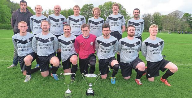 PROUD MOMENT: The Wombleton Wanderers players pose with their league and cup trophies after completing a memorable double in their inaugural season with a 3-2 cup final win over Heslerton