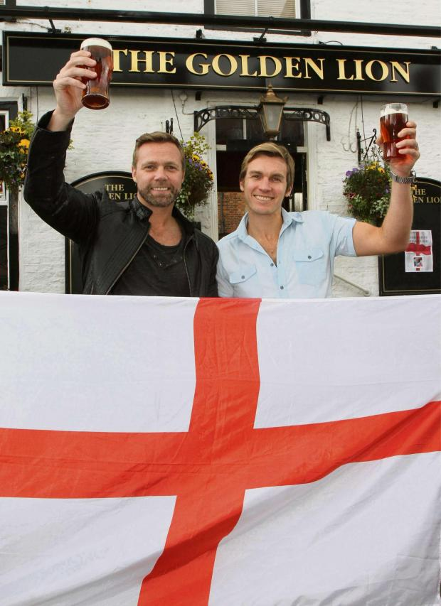 Darlington and Stockton Times: BEER LAUNCH: Journey South, Andy and Carl Pemberton, launching Alternative England World Cup beer at The Golden Lion, Helperby. Picture:RICHARD DOUGHTY