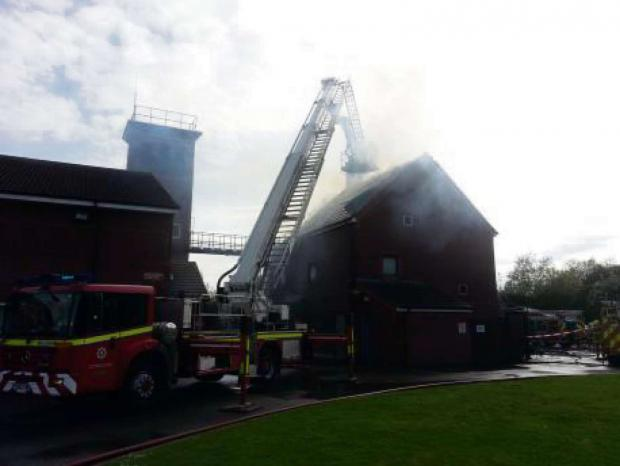 Darlington and Stockton Times: SMOKE ALARM: Firefighters tackle the blaze at North Yorkshire Fire and Rescue's fire training centre, in Easingwold