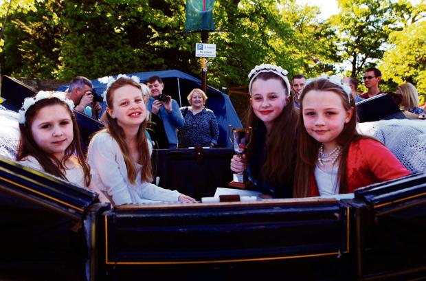 Darlington and Stockton Times: Flower queen Jessica Darnton and her attendants , Megan Elliott, Paige Hymer and Eleanor Savage, at Sedgefield Medieval fair. Picture: SARAH CALDECOTT (6303955)