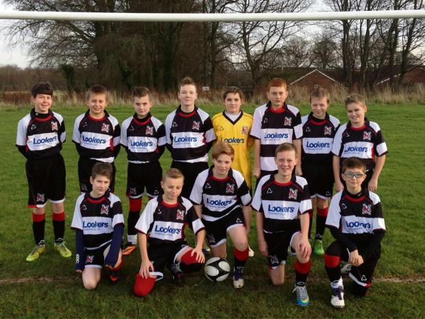 NO SUPPORT: Darlington Junior FC U13 Rockets, which coaches and families say has not been supported by the Quakers