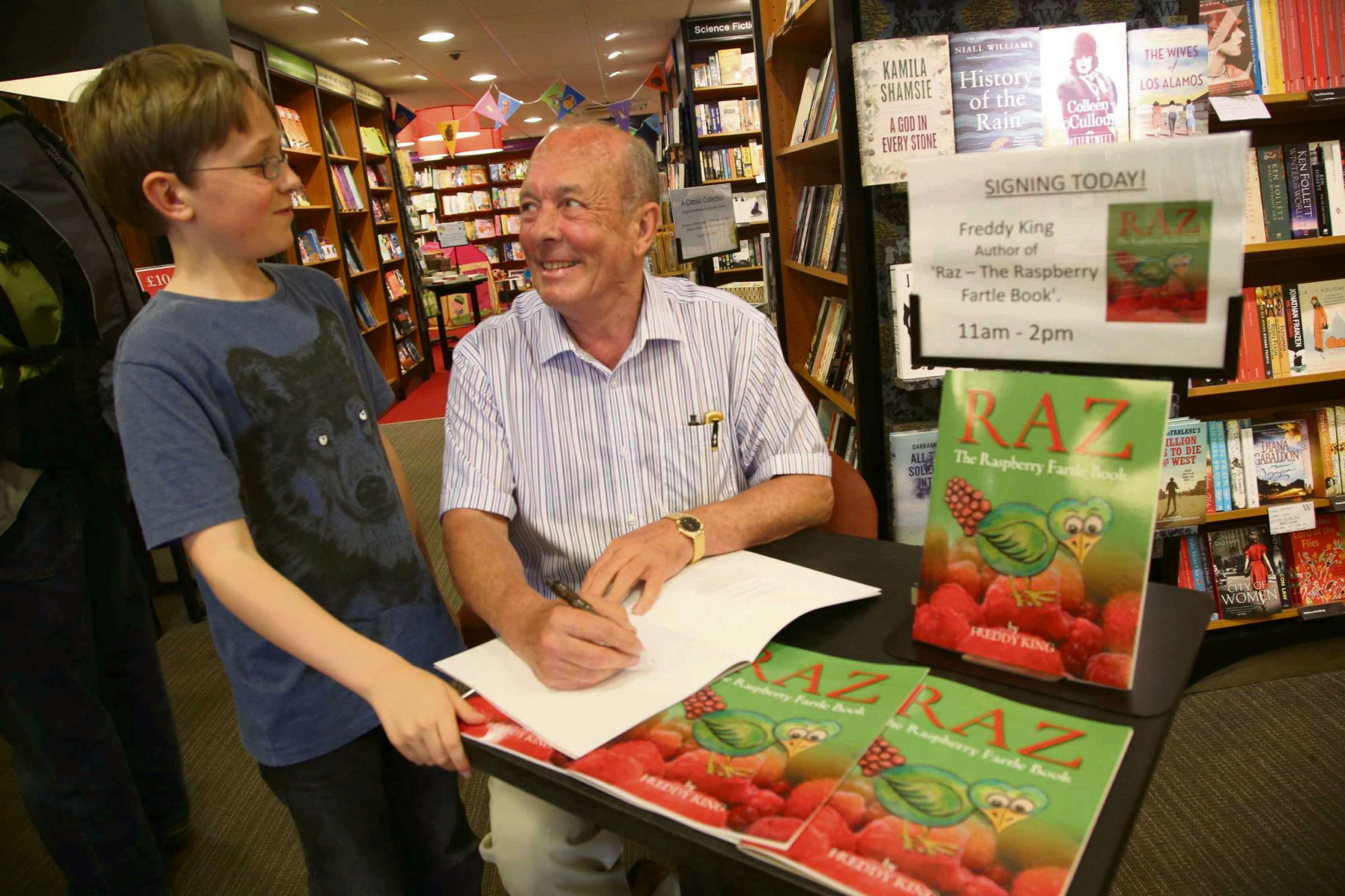 RAZ FAN: Author Freddy King signs a copy of Raz for eleven-year-old Leon Nicholas from Northallerton at the town's Waterstone's book store. Picture: ANDY LAMB