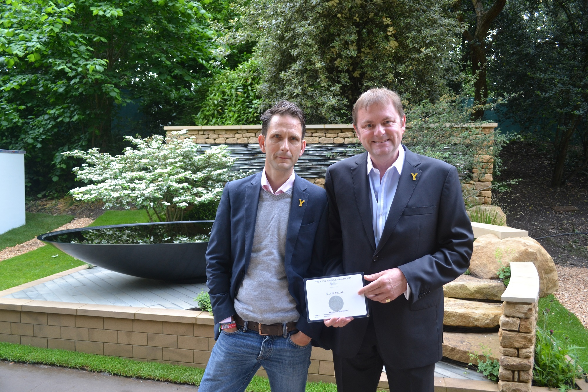 FLOWER SHOW: Designer Alistair Baldwin, left, with Gary Verity and the award winning garden