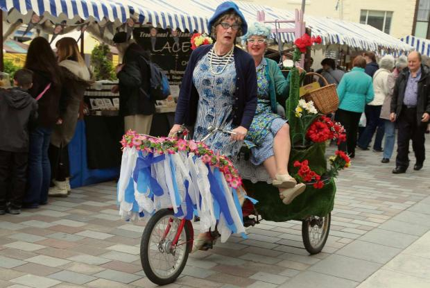 Darlington and Stockton Times: HOUSEWIFE'S CHOICE: Tricycle-riding tea ladies entertain shoppers at at Distinctly Delicious Darlington Festival of Food   Picture: ANDY LAMB
