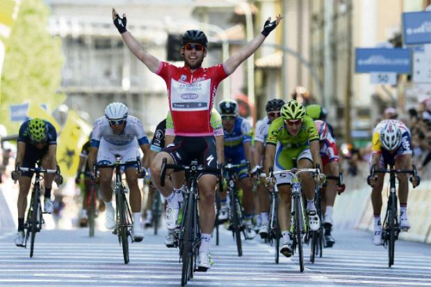 Darlington and Stockton Times: Tour star: Mark Cavendish celebrates as he crosses the finish line to win the final stage of the Giro d'Italia, Tour of Italy cycling race last year.