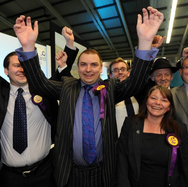 Darlington and Stockton Times: Newly elected Jonathan Arnott ( centre of pic with pin stripe suit) celebrating after being elected as a MEP at the Sunderland Tennis Centre