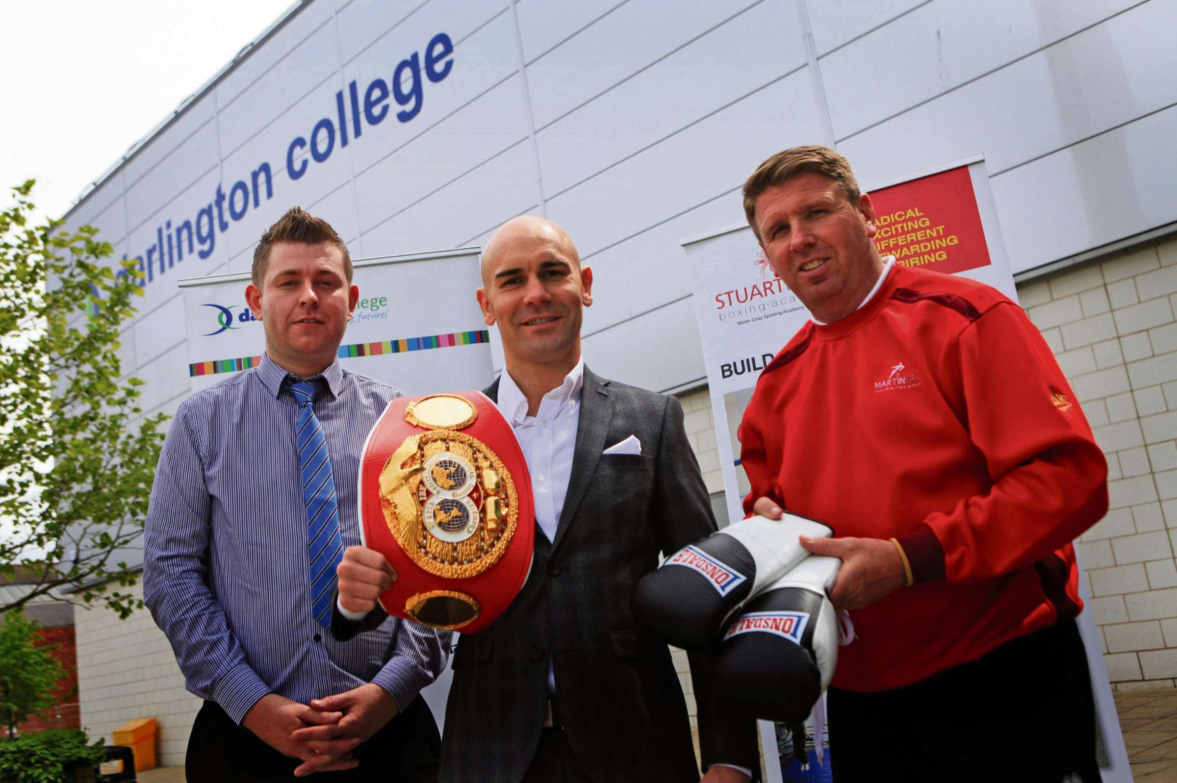 FIGHTING CHANCE: : Stuart Hall (centre) at Darlington College with Darlington FC manager Martin Gray (right) and Alan Jones head of Curriculum. Picture SARAH CALDECOTT