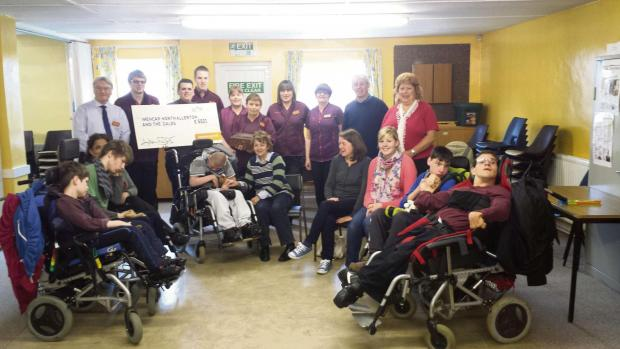CHARITY PARTNERS: Sainsbury's staff present their cheque to Mencap in Northallerton.