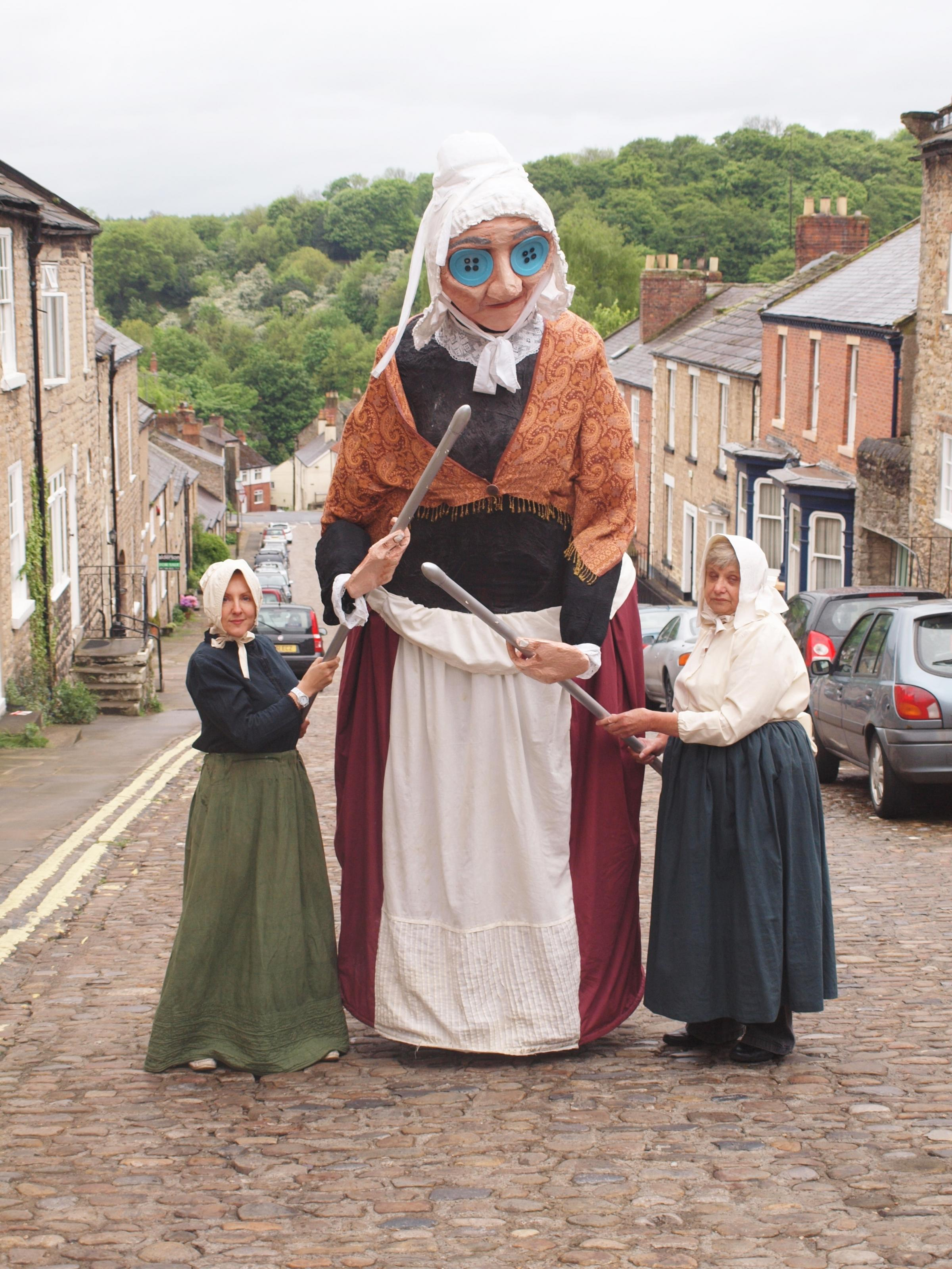 GIANT KNITTER: Community play Blame it on Bartle! will be staged across Richmondshire in July. From left: Susan Jinks, Margaret Cowan (inside puppet) and Linda Baldry. Credit Beki Harrison.