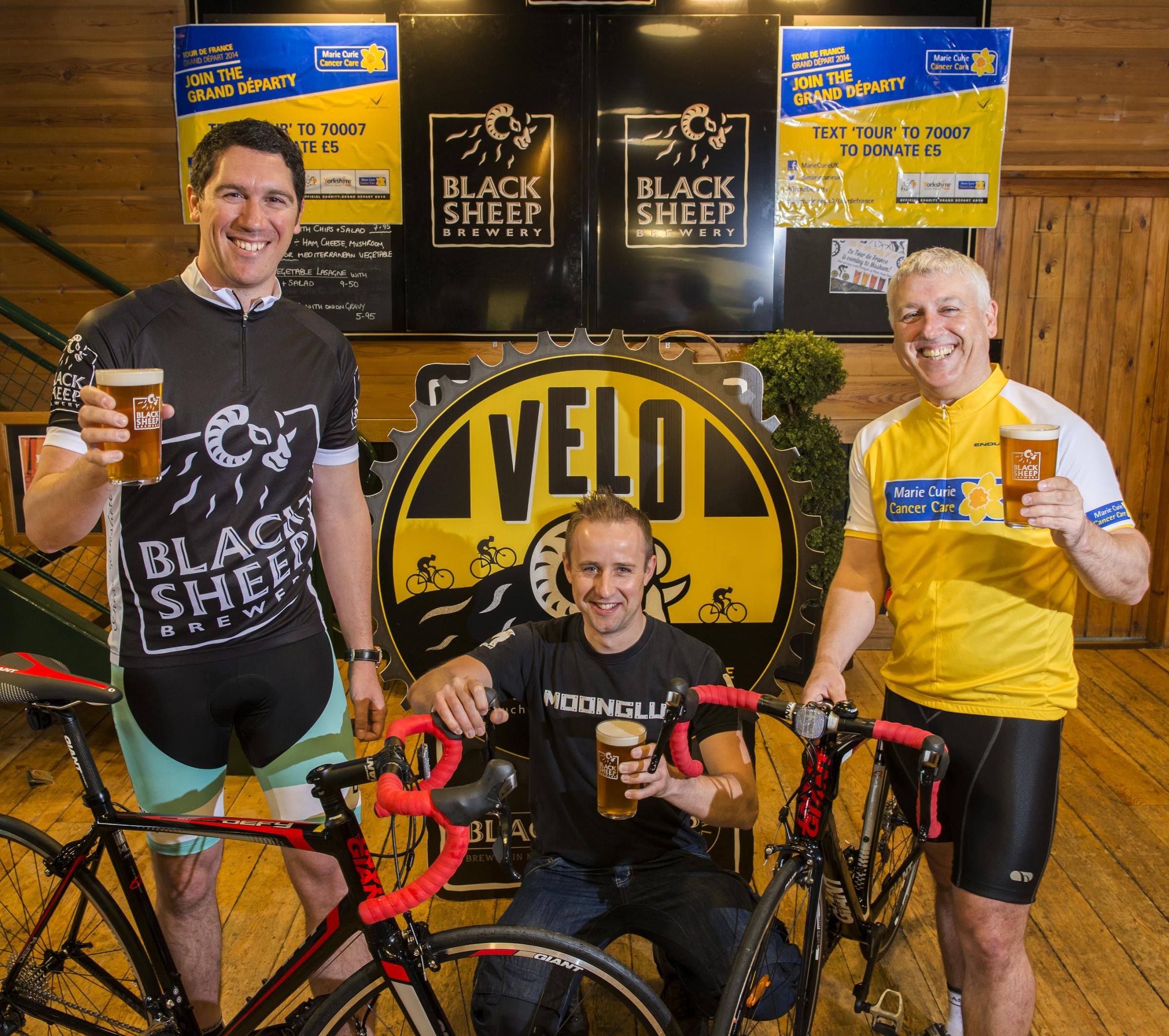 CHEERS ALL: Jo Theakston of the Black Sheep Brewery, Neil Dunkley, owner of Moonglu and Power Peloton rider Mike Hughes.