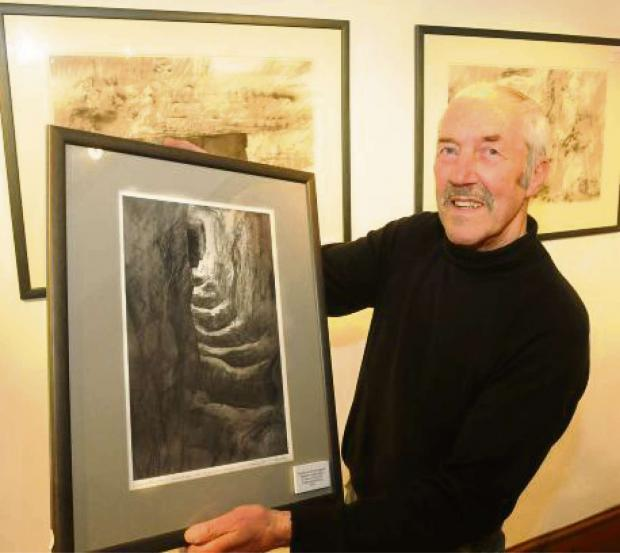 Darlington and Stockton Times: WAR ART: Robert Perry with one of his pictures showing shattered infantry shelters at Verdun.